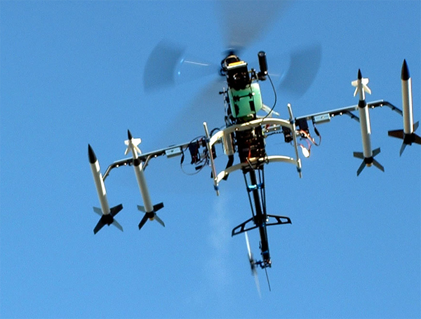Gas Powered Radio Control Helicopter modified to remotely fire model rockets by Christopher Conte